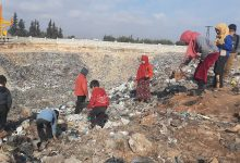Photo of In northwestern Syria's displacement camps, children search for warmth, income in garbage dumps